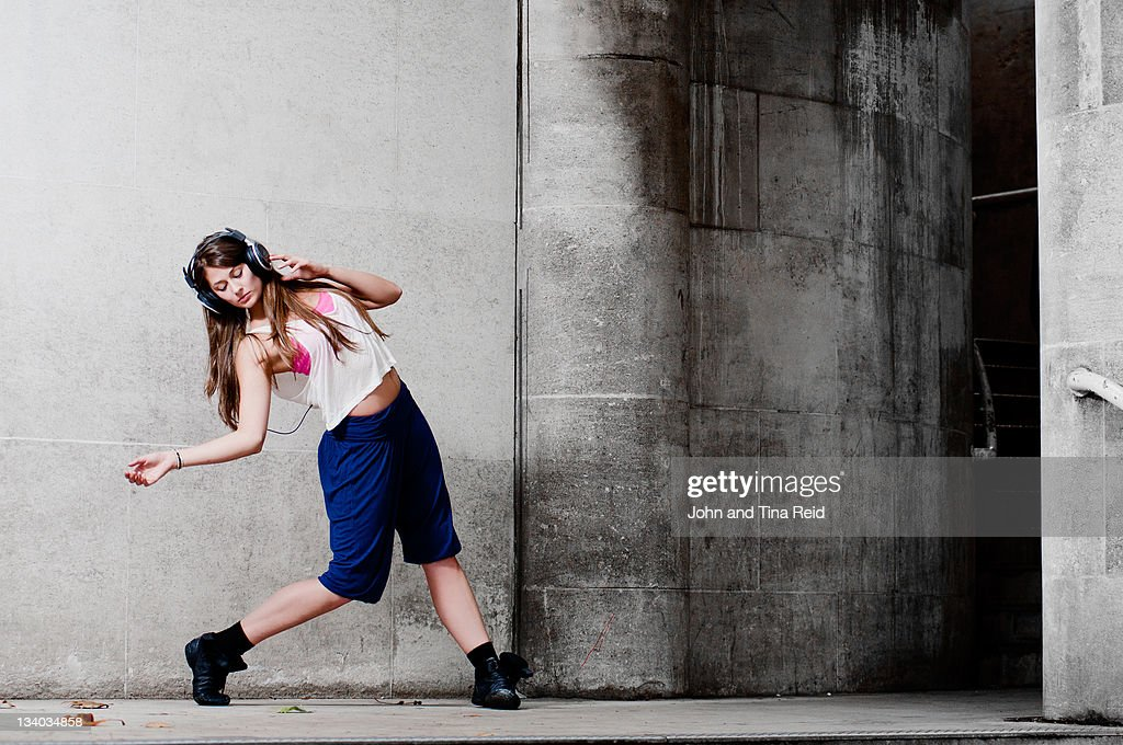 Woman dancing on street : Stock Photo