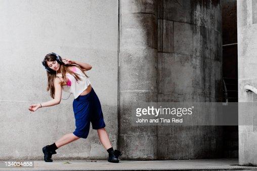 Woman dancing on street : Stock Photo