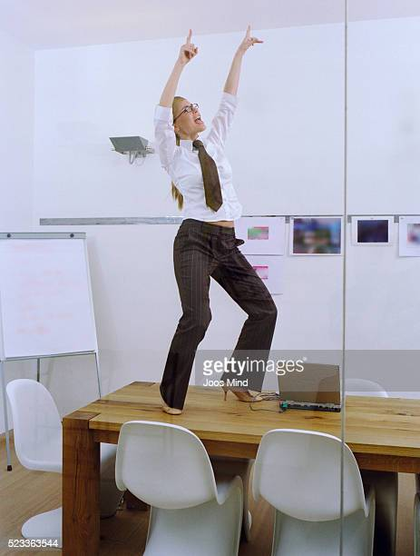 Woman Dancing on Table in Office