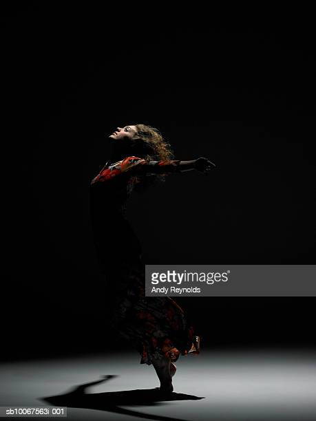 Woman dancing, side view