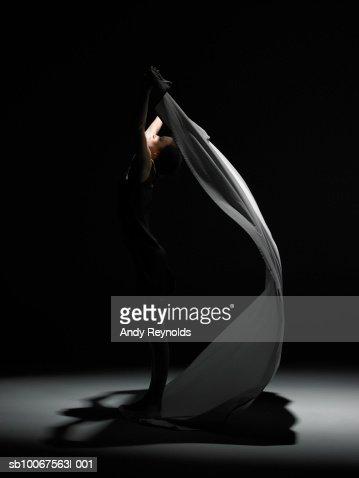 Woman dancing, side view