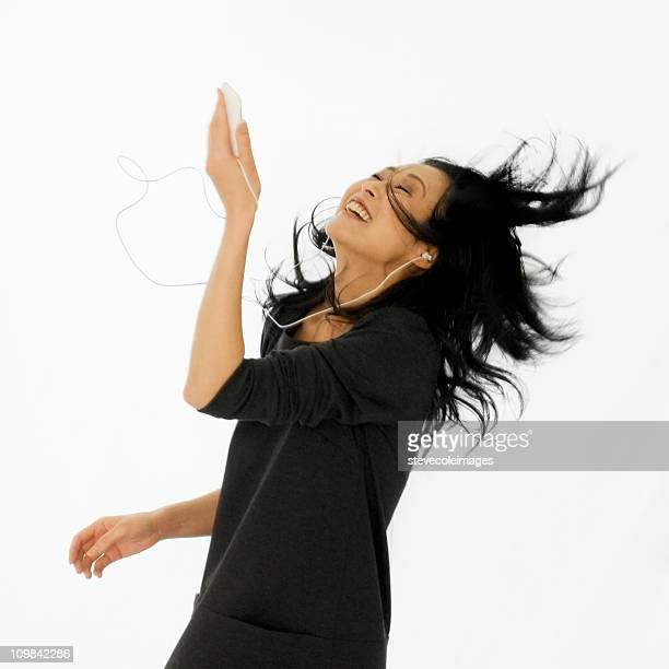 Woman Dancing to a Digital Music Player - Isolated