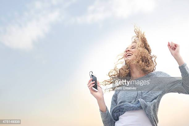 Woman dancing to music