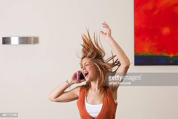 woman dancing while on phone