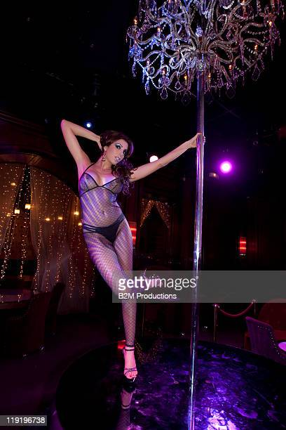 Woman dancing with a pole in nightclub