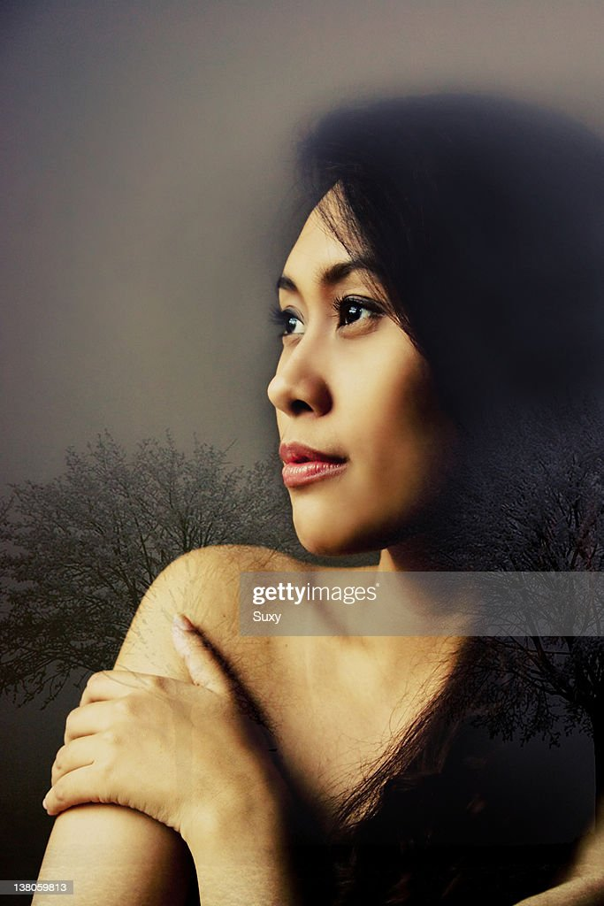 Woman daydreaming : Stock Photo