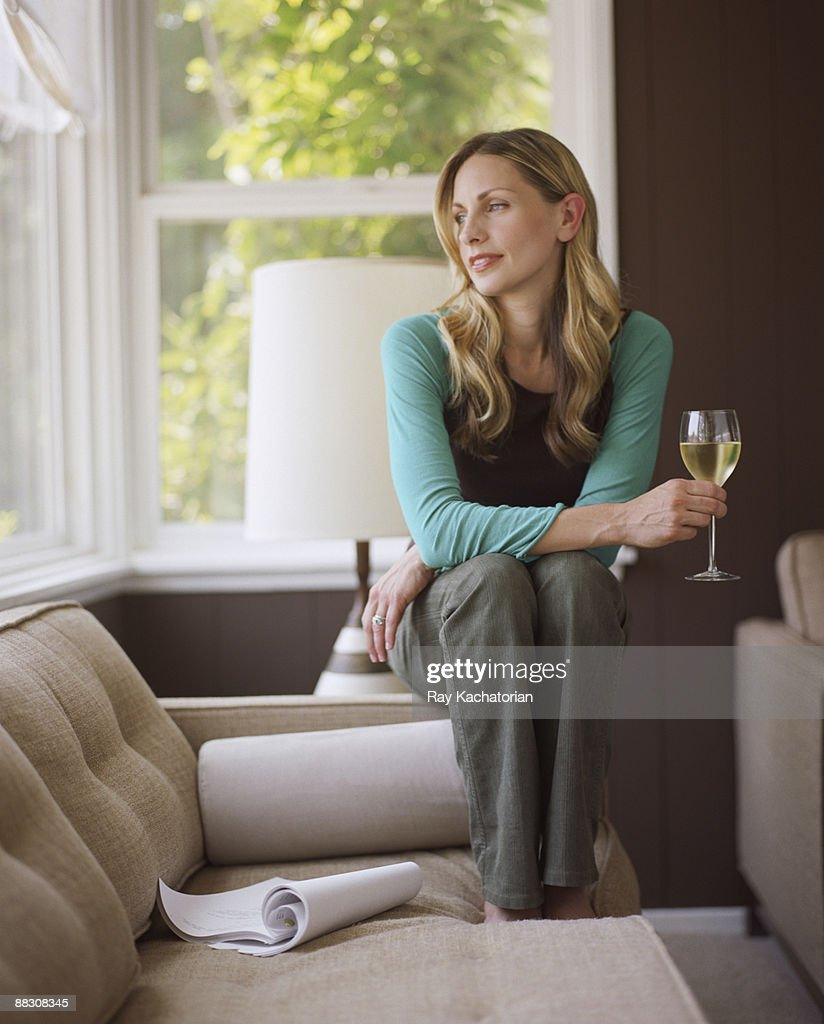 Woman daydreaming with glass of wine : Stock Photo