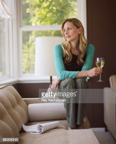 Woman daydreaming with glass of wine : Foto de stock