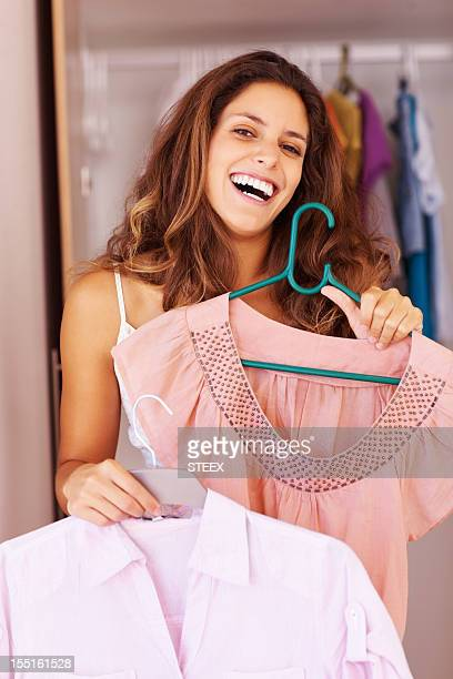 Woman deciding which dress to wear