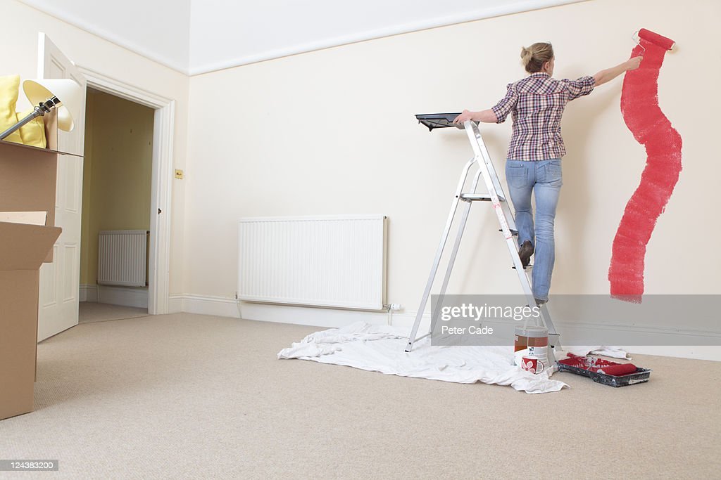 Woman decorating a new home. : Stock Photo