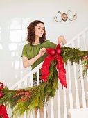 Woman decorating banister
