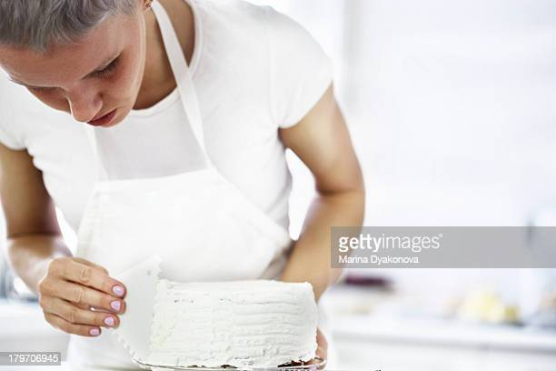 Woman decorating cake