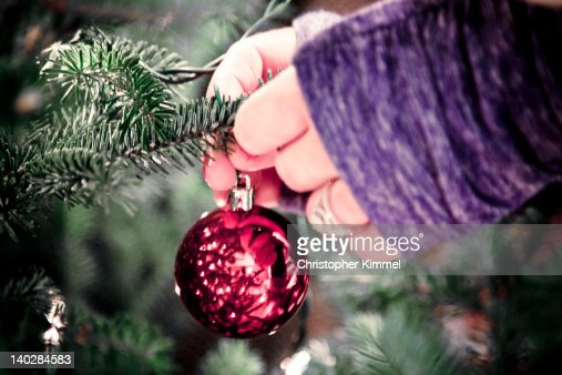 Woman decorating Christmas tree : Stock Photo