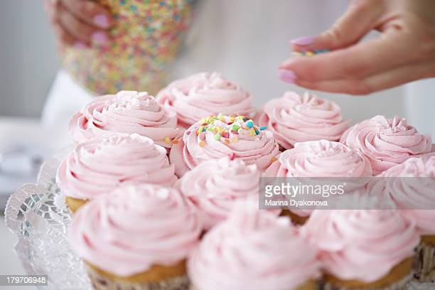 Woman Decorating Cupcakes decorating a cake stock photos and pictures | getty images