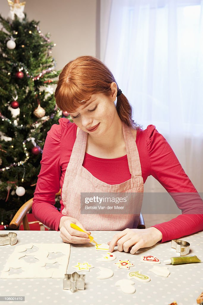 Woman decorating cut out cake decorations.  : Stock Photo