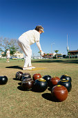 Woman delivering ball in lawn bowling