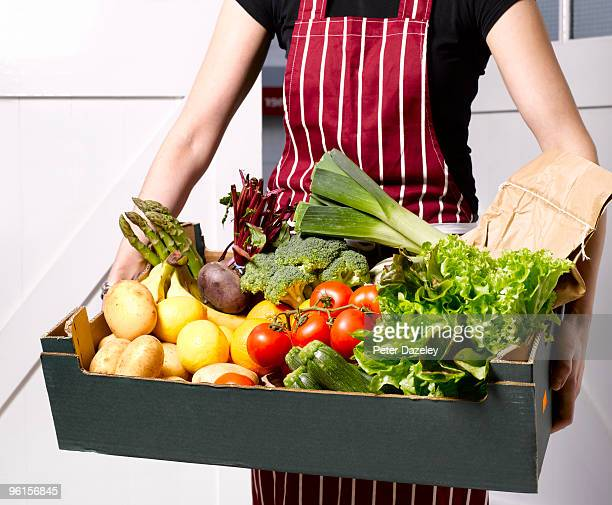Woman delivering fruit and vegetable box