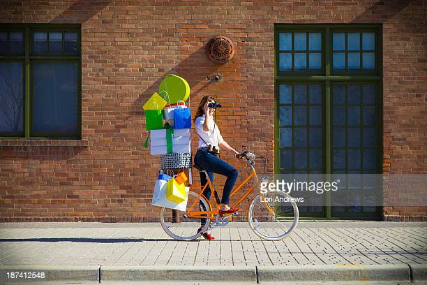 woman delivering shopping packages on bike