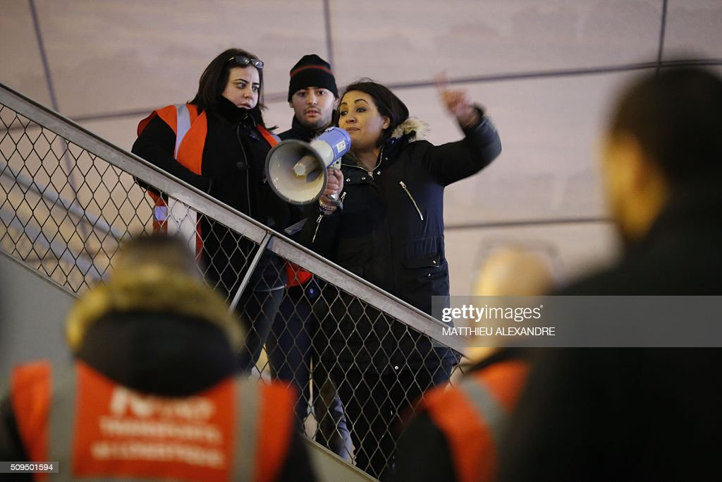 A woman delivers a speech as Uber and other ride-hailing companies, known in France as 'voitures de tourisme avec chauffeur' (VTC), a class of companies that allow passengers to book rides with independent professional chauffeurs, gather at Porte Maillot in Paris on February 11, 2016, to defend jobs they believe are threatened by measures the government recently announced in favor of taxis. / AFP / MATTHIEU ALEXANDRE