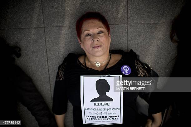 A woman demonstrates against 'femicide' in front of the La Moneda presidential palace in Santiago on June 3 2015 Chile along with Uruguay are joining...