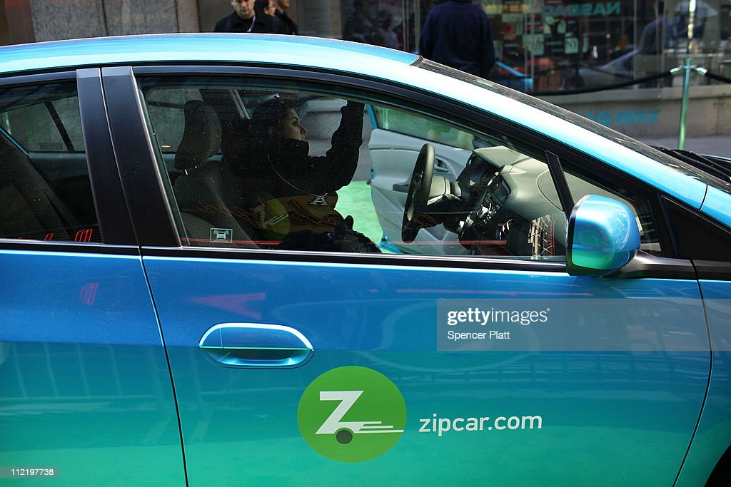 A woman demonstrates how to register into a Zipcar during a promotion of the short term car rental company on April 14, 2011 in Times Square in New York City. Zipcar debuted on the Nasdaq Stock Market today under the symbol ZIP and saw its stock surge 67% on its first day of trading.