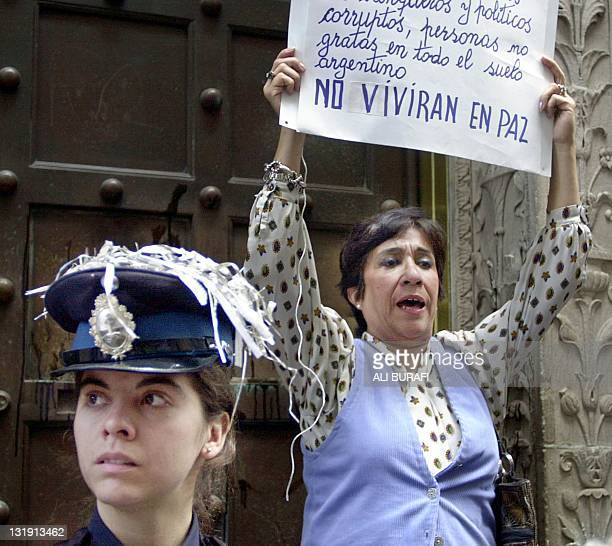 A woman demonstrates in front of the banco Boston in the financial zone of Buenos Aires Argentina 27 May 2002 President Eduardo Duhalde set a oneweek...
