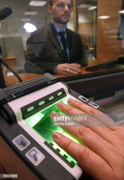 A woman demonstrates the US of a fingerprint scanner at Munich's US consulate 13 December 2007 The US Homeland Security Council decided that the US...
