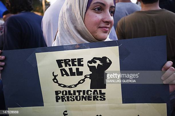 A woman demonstrates with hundreds on July 01 2012 in front of the presidential palace in Cairo to demand the realease of political prisoners...