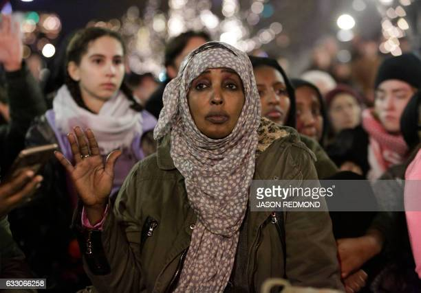 A woman demonstrates with others in support of immigrants and refugees in Seattle Washington on January 29 2017 US President Trump signed the...