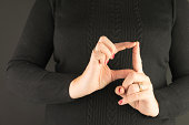 Woman's hands demonstrating sign language letter d