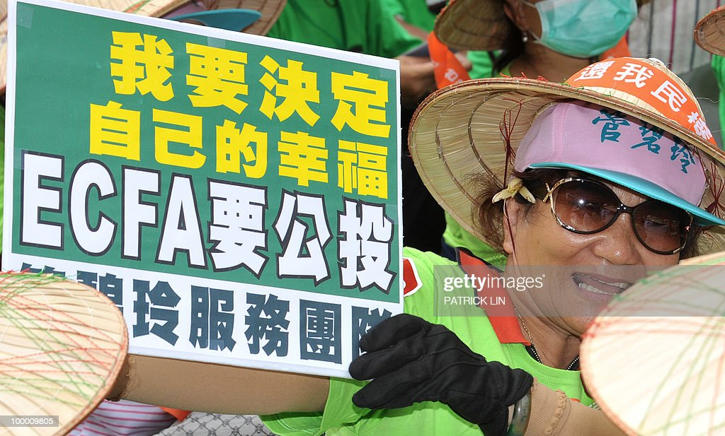 A woman demonstrator holds a sign during a sit-in protest in Taipei on May 20, 2010. Hundreds of supporters of Taiwan's major pro-independence opposition rallied in the capital city as part of the party's efforts to stop the government from forging a trade pact with China. The sign reads: 'I want to decide my own future, ECFA must be decided through referendum.' ECFA stands for Economic Cooperation Framework Agreement, a contentious trade pact Taiwanese government plans to sign to sign with China.