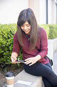 A Millennial Japanese Woman Depositing Checks with Mobile
