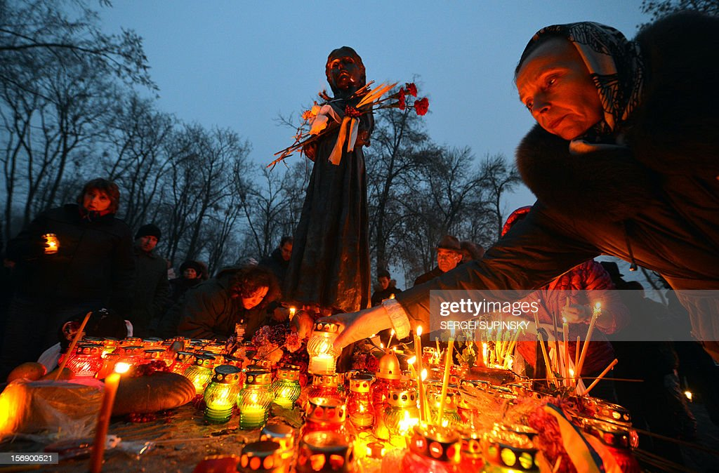 A woman deposits a candle in memory of the victims of the Holodomor famine during a ceremony at the Holodomor memorial in Kiev on November 24, 2012. Ukraine marked 80 years since the Stalin-era Holodomor famine, one of the darkest pages in its entire history that left millions dead and which is regarded by many as a genocide. The 1932-33 famine took place as harvests dwindled and Josef Stalin's Soviet police enforced the brutal policy of collectivising agriculture by requisitioning grain and other foodstuffs.