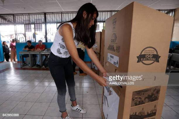 A woman deposits her vote in a ballot box at a polling station in Guayaquil during Ecuador's general elections on February 19 2017 Ecuador's...