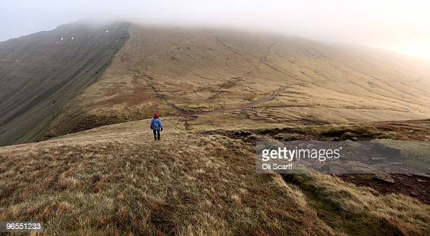 A woman descends the mountain 'Cribyn' in cold conditions in the Brecon Beacons National Park on February 6 2010 in Brecon Wales The Brecon Beacons...