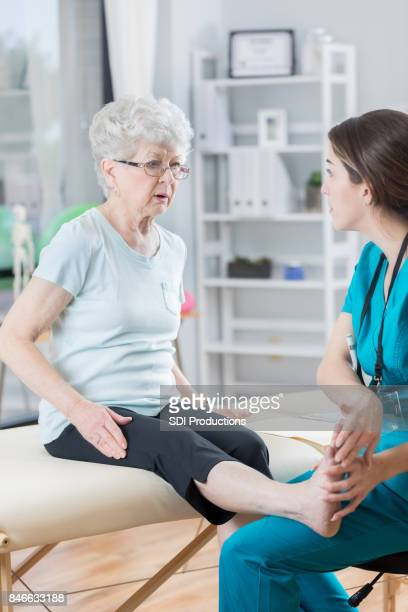 Woman describes leg pain to healthcare professional