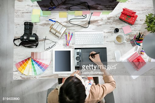 woman designer working on the pen table : Stock Photo