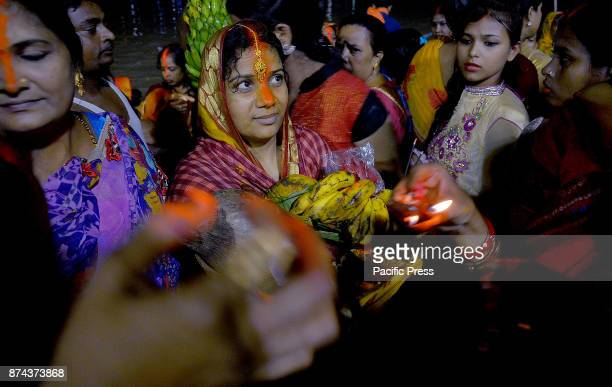 A woman devotee offers prayer on the occasion of Chhath puja in kolkata in India