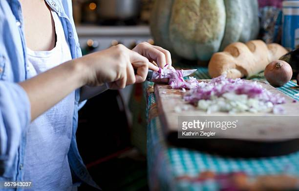 woman dicing onions, close-up of hands