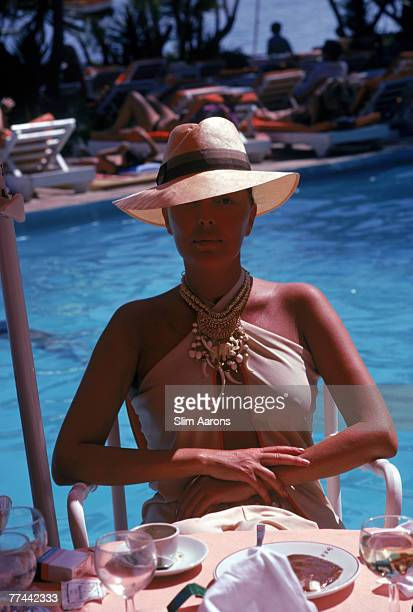 A woman dining by a pool in Marbella Spain August 1982