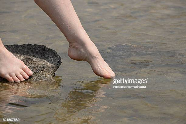 Woman dipping her toes in the sea