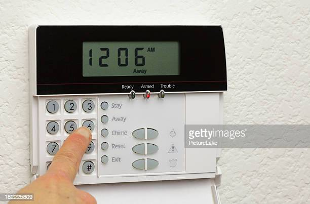 Woman disarming a home alarm