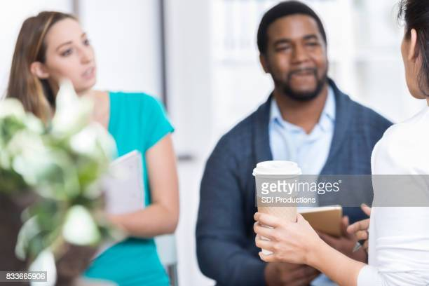 Woman discusses something during group therapy