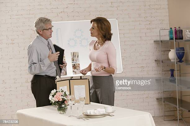 Woman discussing plans with wedding planner