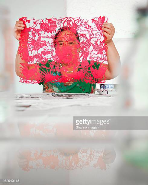 Woman displaying her paper cut-out