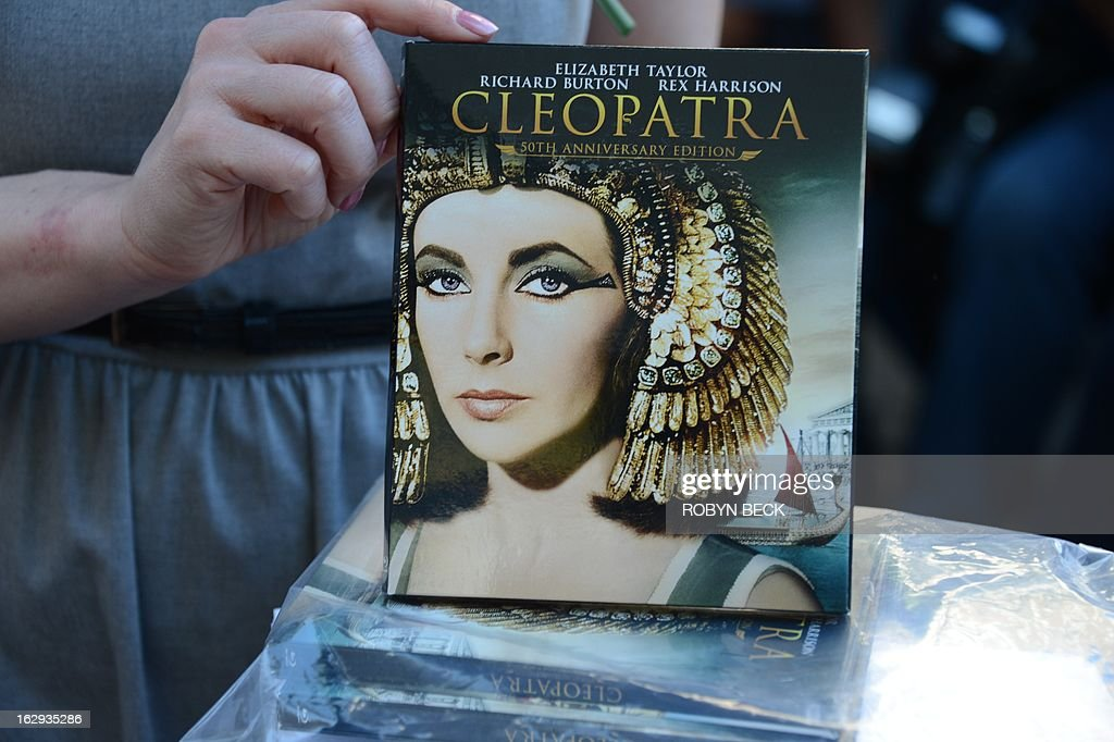 A woman displays 20th Century Fox Home Entertainment's soon to be released 50th anniversary Blu-ray edition of the film 'Cleopatra' starring Richard Burton and Elizabeth Taylor, at the ceremony to honor Richard Burton with a star on the Hollywood Walk of Fame on March 1, 2013 in Hollywood, California. The star was unveiled as part of the 50th anniversary celebrations for the movie 'Cleopatra' and is located beside that of co-star Elizabeth Taylor. AFP PHOTO/Robyn BECK