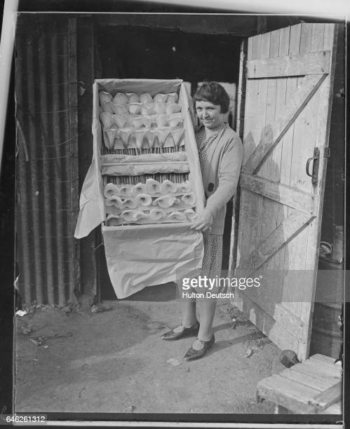 A woman displays a box of beautiful arum lilies packaged for the journey to London where they will be sold in time for Easter Hextable March 1931