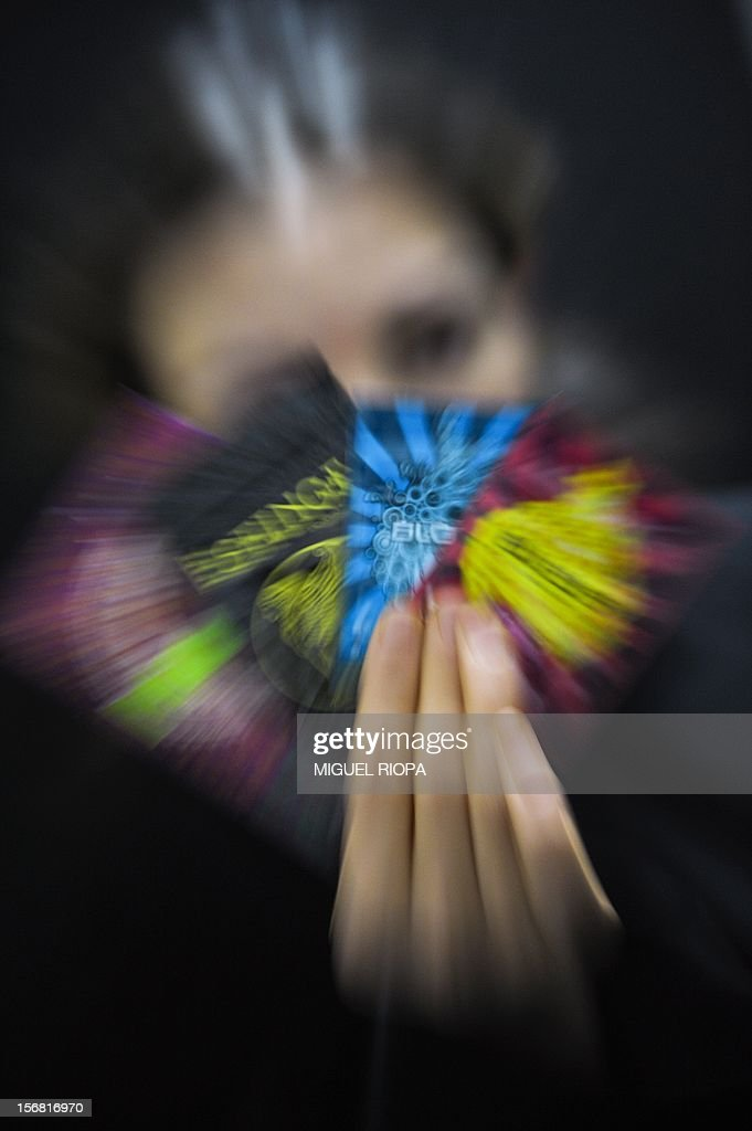 A woman displays different packages containing legal euphoric stimulants sold like plants feeder into a 'smart shop' in Lisbon, on November 20, 2012. AFP PHOTO/ MIGUEL RIOPA
