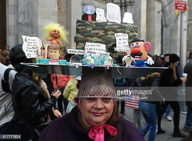 A woman displays her Easter finery as they walk down Fifth Avenue in New York during the annual Easter Parade and Easter Bonnet Festival March 27...