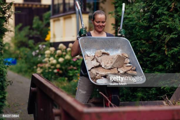 Woman disposing old plaster.